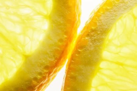 Orange Slices on White background. Shining Through. Macro Image of Ripe Orange for Background. Banco de Imagens