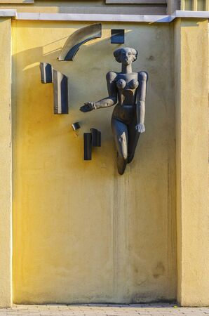 Grodno, Belarus- May 26, 2018: The sculpture on the facade of the building is a stylized female nude. Architectural element of the era of the USSR