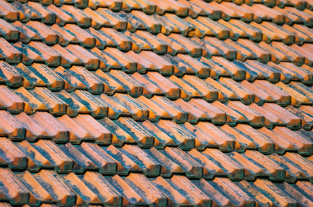 Old Red Ceramic Roof Tiles Background. Old pitched roof