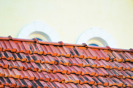 Old Red Ceramic Roof Tiles Background. Old Pitched Roof. Roof Ridge