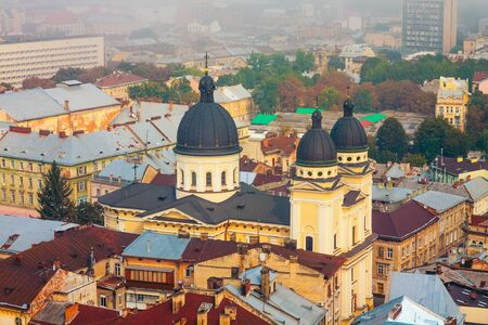 Lviv, Ukraine- September 1, 2018: Church of Transfiguration. Foggy Morning of the City Center from Town Hall Tower. Roofs of the Old City