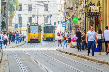 Lviv, Ukraine- September 1, 2018: Street of Old Tourist Town with Yellow Tram