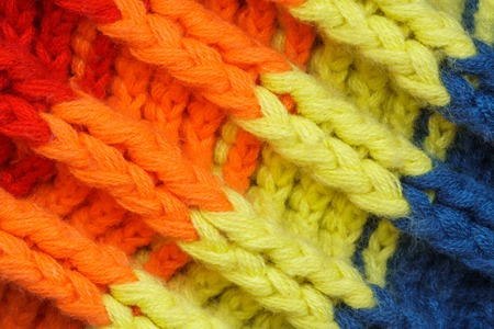 Multicolored Knitwear Sweater Fabric Texture. Bright saturated background