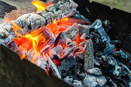 Fire woods and hot coals in bbq pit.