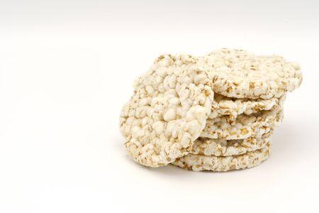 Grain crispbreads on white background. Puffed whole grain crispbread. Dieting Eating Concept. Copy space