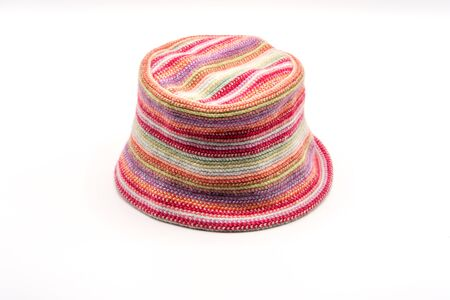 Colorful knitted hat on a white background. Handwork. Fashion concept for men, women and children.