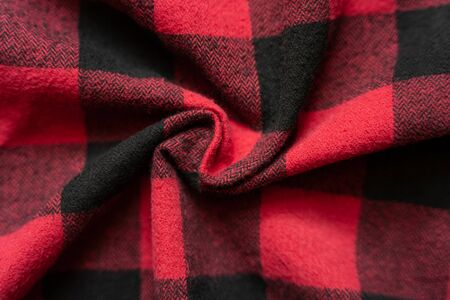 Wrinkled black and red cell clothes background. Fabric with black red cages pattern. Plaid material. Crumpled Cloth Blank Background Banco de Imagens