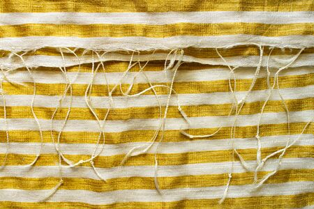 Yellow-White Striped Fabric Background. Gold Metallic Thread Striped Knitted Fabric