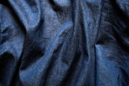 Navy blue fabric texture background top view. Crumpled Cloth Blank Background