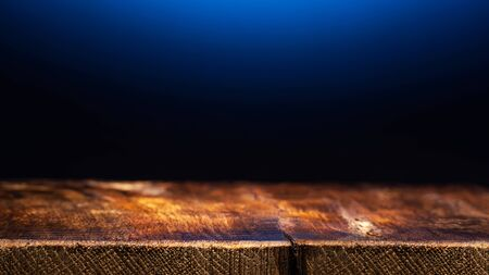 Empty Wooden Table on Dark Blue Background. Backdrop for Product Placement 版權商用圖片 - 134102675