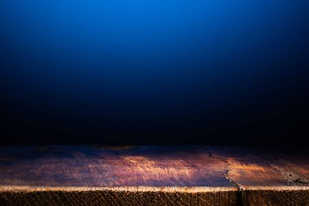 Empty Wooden Table on Dark Blue Background. Backdrop for Product Placement
