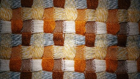 Knitwear Fabric Background of Blanket with a Complex Square Interweaving
