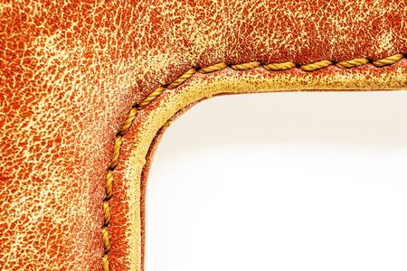 Inner corner of a leather product on a white background
