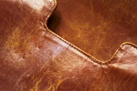 Detail of an old leather bag briefcase close up