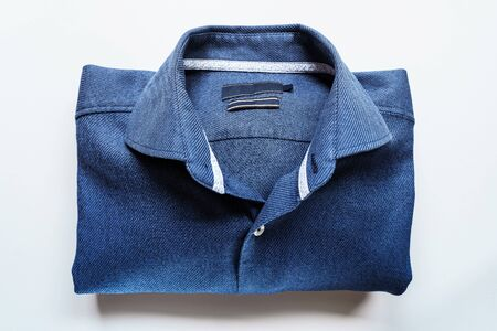 Blue Man Shirt on White Background. Clothes background 版權商用圖片