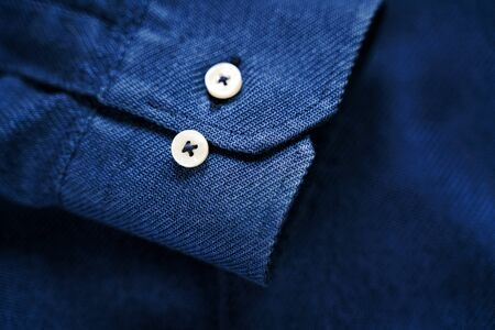Blue Shirt Sleeve with Buttons. Blue fabric texture. Tailor background