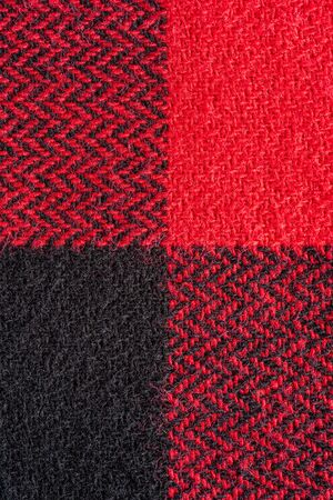 Black and Red Fabric in a Cage. Blanket Material. Clothes Background