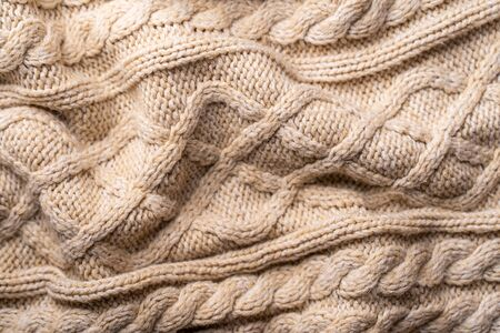 Beige Knitwear Fabric Texture with Pigtails. Beige Knitted Background.