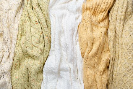 Several Different Knitted Sweaters Lays Side by Side as Background 版權商用圖片