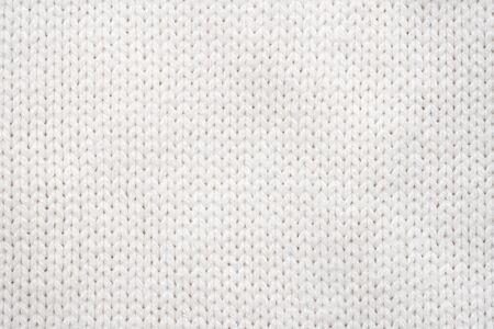 Weißer Strick-Gewebe-Hintergrund. Wollpullover Textur Nahaufnahme Standard-Bild