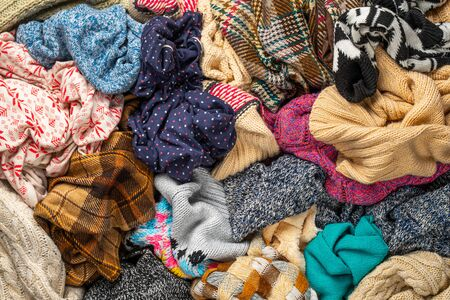 A Bunch of Different Clothes. Recyclable Textile Background. Sorting at Recycling Clothes Stock fotó