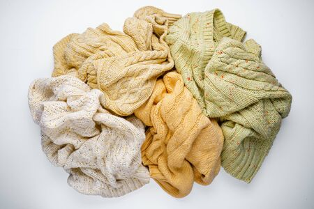 Pile of Knitted Sweaters on a White Background 版權商用圖片