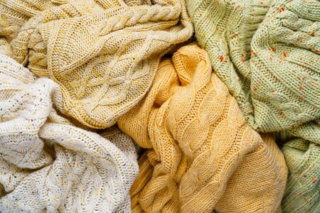 Pile of Knitted Winter Sweaters. Piles of clothes background 版權商用圖片