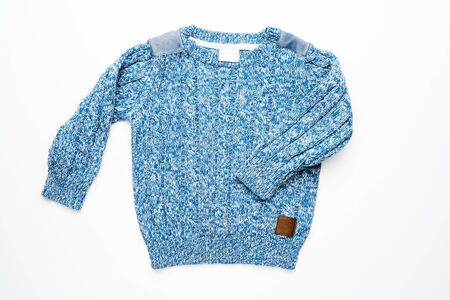 Kids knitted sweater with pattern. Beautiful blue woolen autumn sweater with long sleeves. Front view. On white background Foto de archivo