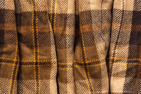 Brown checked fabric. Scottish wool. Fabric for coat plaid suit. Close-up. Background Archivio Fotografico