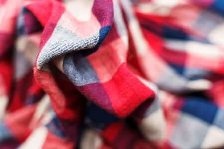 Plaid material texture. Red, blue and white cage clothes background Archivio Fotografico