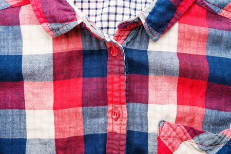 Plaid Material Shirt Background. Front of Shirt Elements: pocket, collar, buttons as Background