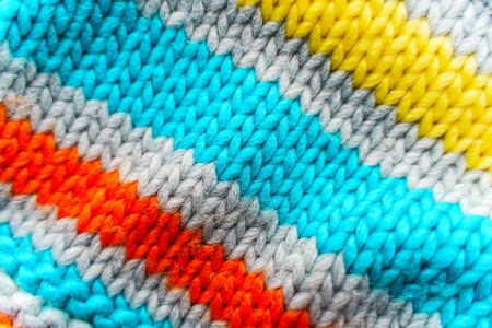 Striped colorful knit sweater texture. Empty copy space background with saturated sweater. Hobby background