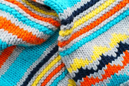 Colorful knit sweater background. Empty copy space background with saturated sweater. Hobby background