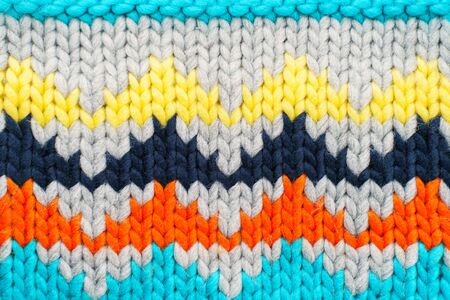 Handmade knitted multi-colored pattern. Hobby background