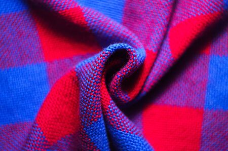 Plaid material. Red and blue cage clothes. Crumpled twisted fabric background 版權商用圖片