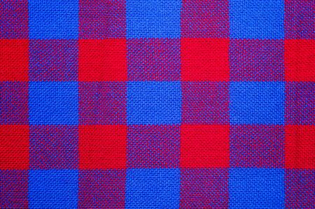Plaid material. Red and blue cage clothes background 版權商用圖片 - 140391073