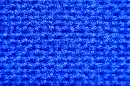 Plaid material. Blue clothes background macro