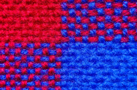 Plaid material. Red and blue clothes background close up macro shot
