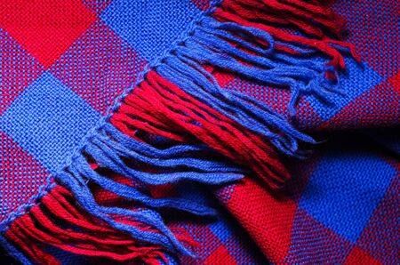 Blue and red checked scarf with fringe as background 版權商用圖片 - 140391111