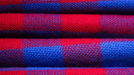 Plaid material. Red and blue cage clothes background 版權商用圖片 - 140391140