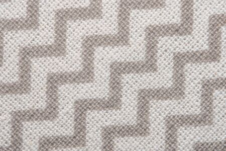 Pattern of gray and white striped zig zag. Macro textile texture