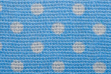 Blue and white spot pattern can be used for background. Polka dot macro texture of textile