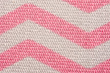 Pattern of pink and white striped zig zag. Macro textile texture Banque d'images - 145247258