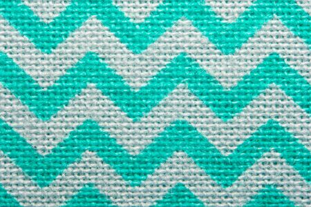 Pattern of blue and white striped zig zag. Macro textile texture