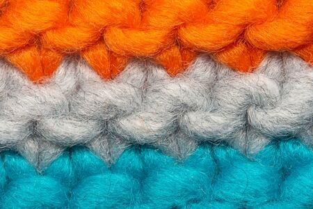 Colorful knit sweater texture macro. Empty copy space background with saturated sweater. Hobby background Banque d'images - 144907126