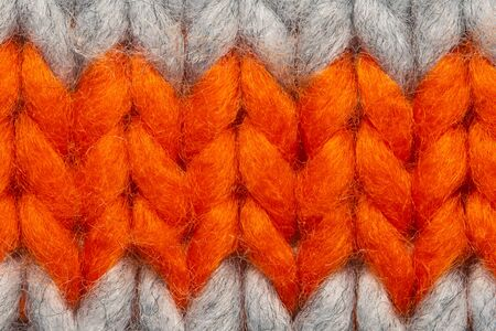 Colorful knit sweater texture macro. Empty copy space background with saturated sweater. Hobby background Banque d'images - 144907104