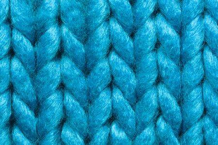 Blue knit sweater texture macro background