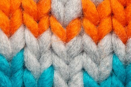 Colorful knit sweater texture macro. Empty copy space background with saturated sweater. Hobby background