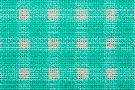 White and green cage clothes background macro