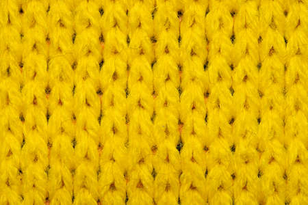 Yellow synthetic knitted fabric texture